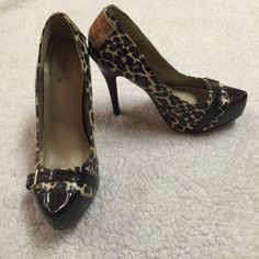 S H O E S Item: Leopard Print High Heels  Features: - Beautiful detailing with the buckle and the heel - Leopard pattern - 4.5 inch heel  Condition: Excellent; Wore maybe two or three times  Price: Negotiable   Reason for Selling: Never wear Qupid Shoes Heels