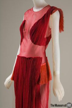 Helmut Lang was an early proponent of techno fabrics and a designer of urban, minimalist clothing. This dress features an unusual combination of materials: delicate silk chiffon with a dramatic cascade of synthetic horsehair. Lang has retired from fashion and now works as an artist.