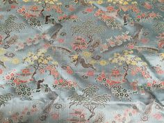 "Vintage Silver Blue Asian Satin Brocade with Lovely Scene of Trees, Dragons, and Pagodas 28"" PRICE PER YARD- satin brocade, cheongsam fabric"