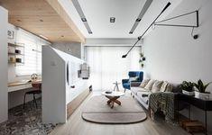 Lorsque le studio de design d'intérieur taïwanais NORDICO a conçu la disposition de cet appartement à Taipei, ils ont dû faire preuve de créativité pour intégrer dans l'habitation un espace séparé pour un bureau à domicile.  Leur technique a été d'ajouter un mur dans le salon, mais qui n'est pas de pleine hauteur, cela permet de diviser la pièce tout en la laissant ouverte et d'offrir au salon une zone d'affichage pour la télévision et l'unité de stockage. Derrière le mur et à côté de la...