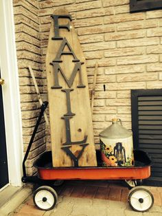 Redone antique ironing board in old wagon Painted Ironing Board, Antique Ironing Boards, Wood Ironing Boards, Iron Board, Repurposed Items, Painted Chairs, Porch Decorating, Country Decor, Interior Design Living Room