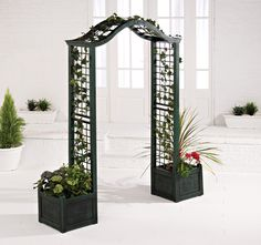 Love how they incorporated the trellis planters with the archway. Perfect for garden entrance!