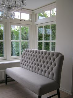 beautiful tufted gray banquette seating - god does exist. and he would sit on this banquette!