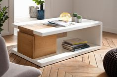 Cameron Wooden Storage Coffee Table In White And Knotty Oak With Drawer And Flap. It is highly fashionable and trendy. This rectangular design coffee table will sit beautifully in the centre of you.