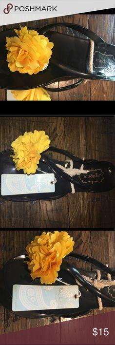 NWT - Mud Pie Black Jelly Flip Flops NWT - Mud Pie black jelly flip flops with yellow flower. Mud Pie Shoes Sandals
