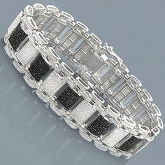Iced Out Bracelets! This 10K Custom White Black Diamond Bracelet weighs approximately 67 grams and showcases 8.47 ctw of black and white diamonds. Featuring an exquisite flexible link design and a fully iced out look, this luxurious men's diamond bracelet is available in your choice of 14 Karat or 10 Karat white, yellow, and rose gold. Please contact us for details.