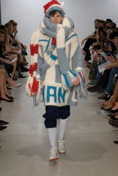 Postmodernist fashion model wearing oversized knitted scarf and jumper
