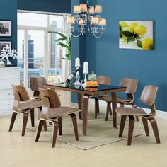 Modernize your dining room decor with the help of these molded dining chairs. Made of durable oak plywood, these mid-century modern chairs come with rubber feet to prevent floor damage and are finished in a beautiful grainy walnut color.