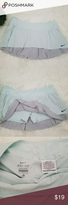 "Nike Dri-  Fit Athletic Golf Tennis Skirt Skort Nike Dri-Fit Athletic Skort Size: Large 86% Polyester, 14% Spandex Made in Cambodia  Light Blue Gray Color Pre- Owned in excellent condition No stains, holes or rips Please verify actual measurements below to ensure proper fit  Actual Measurements:  Waist: 16 1/2"" (x2) Length: 12"" Short Length: 8 1/2"" Short Inseam: 3 1/4"" (Crotch) Leg Opening: 9""  Please contact me for any question or concern. Photos are from actual products. Nike Shorts Skorts"