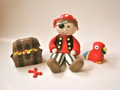 3D fondant Pirate Theme set for cakes. Would be great if I could get in a girly pink theme!