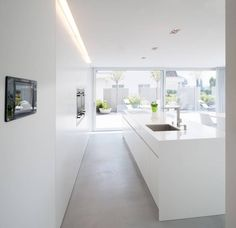Simple lines, clear structures and plain shapes. Colour concept: White A house in Switzerland: discreet design in combination with HI-MACS® Haus in Bronschhofen, Schweiz Kitchen Interior, Interior Design Living Room, Home Interior, Interior Minimalista, Scandinavian Kitchen, Cuisines Design, Modern Kitchen Design, Beautiful Kitchens, Home Kitchens