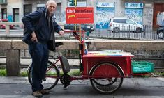 'I'm often faster': Milan's bicycling bookseller takes on the online giants | Italy | The Guardian Milan, Velo Cargo, Don Quixote, The Guardian, Orchestra, Baby Strollers, Competition, The Neighbourhood, Bicycle