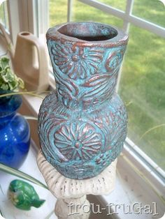 spray paint a copper color, paint over it with turquois. Wipe off with a sheet (not something with nap to it). I want to do this to my bistro set!