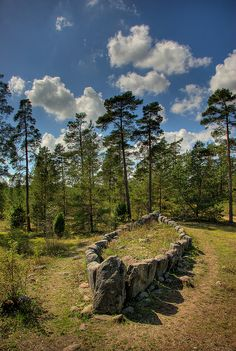 Tjelvar's Grave, Slite, Sweden | Tjelvar's Grave (ca. late Bronze Ages, 1100-500 BC) is one of the best preserved stone ship settings in Gotland (18 metres long and 5 metres wide). According the legend, Tjelvar - the first man lived in Gotland - is buried there. The height of the gunwale stones diminishes towards the centre of the ship, which has also been filled with stones to form a boat-deck. The grave contains a plundered stone-slab coffin, containing cremated bones and a few potsherds.