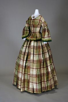 Day dress, 1853-57 From the Chester County Historical SocietyDRESS, 1853-1857 BACK TO ERA BEFORE THE CIVIL WAR  Green, white, and red plaid silk  This green and red plaid silk dress epitomizes the look of the mid-1800s with its wide bell shaped skirt and pagoda sleeves