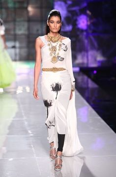 Masaba Gupta cinches this Satya Paul sari-gown with a gold kamarbandh.
