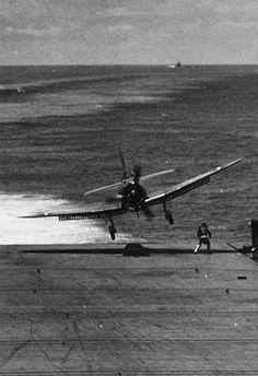 Douglas Dauntless landing on an aircraft carrier.