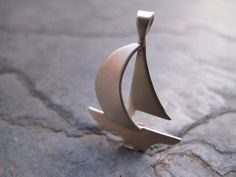 hand fabricated silver sailboat pendant by simplymega on Etsy