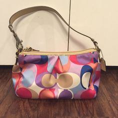 Multicolored Coach Handle Bag This bag is so much fun and is perfect for Summer time. It has been used but is in excellent condition with minor wear. Coach Bags