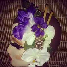 Tiki god hairpiece with stick embellishment and white and purple flowers available for $15 plus shipping perfect for #tikioasis :) #deadlydinaaccessories #tiki #luau #hawaiin #tropical #tikistatue #purpletones #whiteflowers #hairflowers #hairpiece #hairaccessories #pinup #retro #rockabilly #vintageinspired