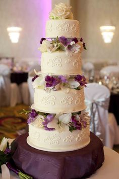 I designed my own wedding cake, having each tier feature a different element of my gown. But of all the cakes I looked at online and in magazines, this was the was mine was most inspired by. Each tier had a (column) lift in between, covered by my purple hydrangeas. Fine detail white on white piping. <3 LOVED it.