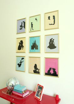 Gallery wall of Disney silhouettes - plain gold frames from the Dollar Tree, scrapbook paper and cardstock silhouettes.
