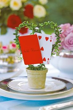We love the idea of incorporating playing cards (hearts especially) into wedding table number displays.
