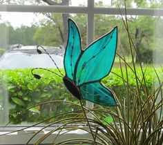 Teal Green and White Wispy Translucent Stained Glass Butterfly (Side View) - Handcrafted Plant/Garden Stake. $16.95, via Etsy.