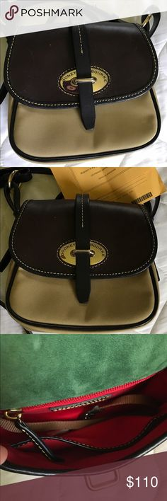 Dooney & Bourke Crossbody Adorable Dooney & Bourke Crossbody bag. Heavy leather flap, trim, and strap with heavy canvas body. Brass hardware and closure. Back pocket with leather strap closure and one inside zip pocket and one open pocket. Strap is adjustable. Perfect for any Fall or Winter wardrobe. Excellent used condition. Dooney & Bourke Bags Crossbody Bags