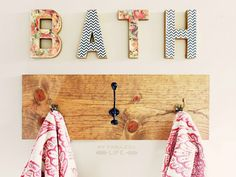 """My Fabuless Life: DIY Towel Rack and Mod-Podged """"Bath"""" Letters. LOVE the mixed chevron/floral letters. Cute towel bar, too."""