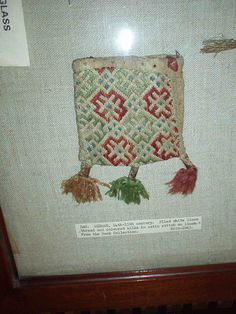 1300-1500, Germany. Brickstitch embroidered pouch. White linen thread and colored silks in satin stitch on linen ground.
