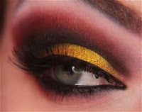 red, brown, and golden yellow dramatic smokey eye