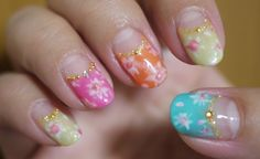 Nail art for the hippie chick in all of us! Fun bright colors. Love.