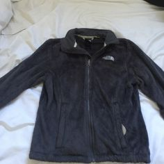 North Face Jacket This was worn at the most 3 times. It is way to hot where I live to get my money's worth out of it. It was expensive to begin with! This is is absolutely perfect condition with no flaws. It is SO soft and warm. The color is a dark charcoal color. North Face Jackets & Coats Vests