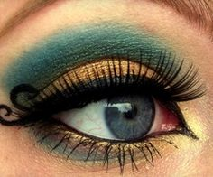 Teal & Gold. Now this is some eye make up...love the little curly q's at the end.