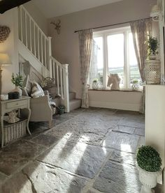 The beautiful stone floor really sets this cottage decor apart and the feminine touches really make it perfect.