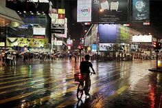 Christophe Jacrot goes for motif hunting when most of us prefer to stay indoors. His Hong Kong in the Rain series features rain-soaked streets, ripples in