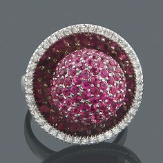 Beautiful pink sapphire ring with a halo of genuine diamonds! One of the fabulous creations by ItsHot.com - available in yellow, rose, and white gold.
