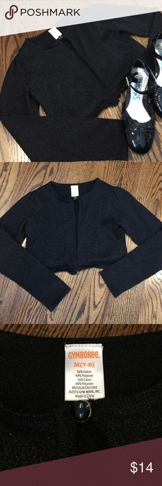 ✨New listing✨One button Gymboree cropped shrug This cropped shrug from Gymboree is black with gold metallic threading throughout giving it a subtle sparkle.  Delightful for dressing up!  Size M (7-8).  Only worn for Christmas Eve last year. Gymboree Shirts & Tops Sweaters