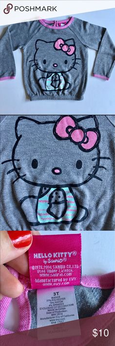 Hello Kitty Pull Over Hello Kitty Pull Over comes in a very soft and light weight polyester/Rayon/Spandex blend with pink trim and glitter screen print. Size: 3T. In excellent condition. Hello Kitty Shirts & Tops Tees - Long Sleeve