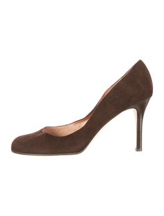 Brown suede Kate Spade New York round-toe pumps with stacked heels.