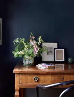 Elements of Style Blog  Lovely contrast between he soft pinks, wood grain and moody wall.