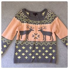 🎉 HP 🆕 Snowflake deer print sweater Gray and pink deer print sweater. Very warm. Size M (fits like a small). Great condition, never worn. Boutique Sweaters Crew & Scoop Necks