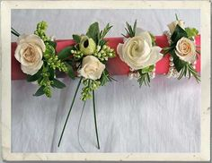 w    Pearly Wrist Corsages incorporating sprigs of Lilac and Rosemary with Ranunculus, Rose Buds, anemones on a bed of Ivy Leaves with Bear Grass.