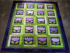 LOVE the purples and greens in this tulip quilt