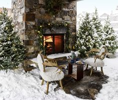 An outdoor fireplace is flanked by a pair of sheepskin-covered moose-antler chairs; the table is made from an antique snowshoe, and the rug is buffalo hide.