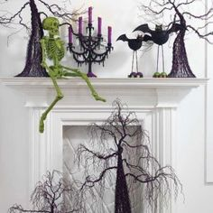 50 Awesome Halloween Decorating Ideas White Fireplace and green Skull