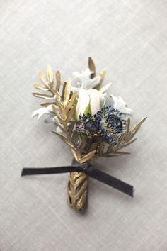 Gold Elegant Wedding Boutonnieres - looks like a bronze to me and I like that better. The blue and the white are also nice in there too