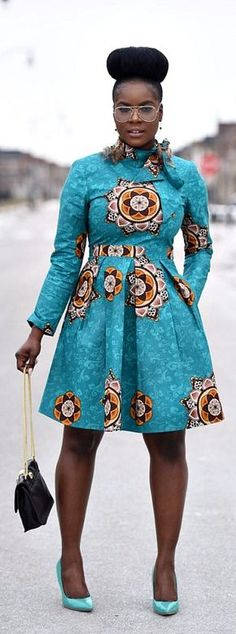 Tilt-Vintage wax print dress. Above the knee pleated dress. Invisible back zipper. Tie Neck Line. 2 side pockets. Mint leave and pink. Ankara | Dutch wax | Kente | Kitenge | Dashiki | African print bomber jacket | African fashion | Ankara bomber jacket | African prints | Nigerian style | Ghanaian fashion | Senegal fashion | Kenya fashion | Nigerian fashion | Ankara crop top (affiliate)