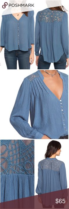 """Free People Canyon Rose Top Blue Glitz up your wardrobe with this blue metallic blouse. Metallic embroidered shoulder and back yolk. Button front and cuffed long sleeve. High/low hem line.  57% RAYON 43% MODAL Machine Wash / Line Dry Measurements from XSmall Length 25-29 Bust 40"""" Reasonable offers welcome. Free People Tops Button Down Shirts"""